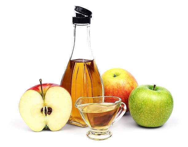 Bottle of Apple cider vinegar and apples. stock photo