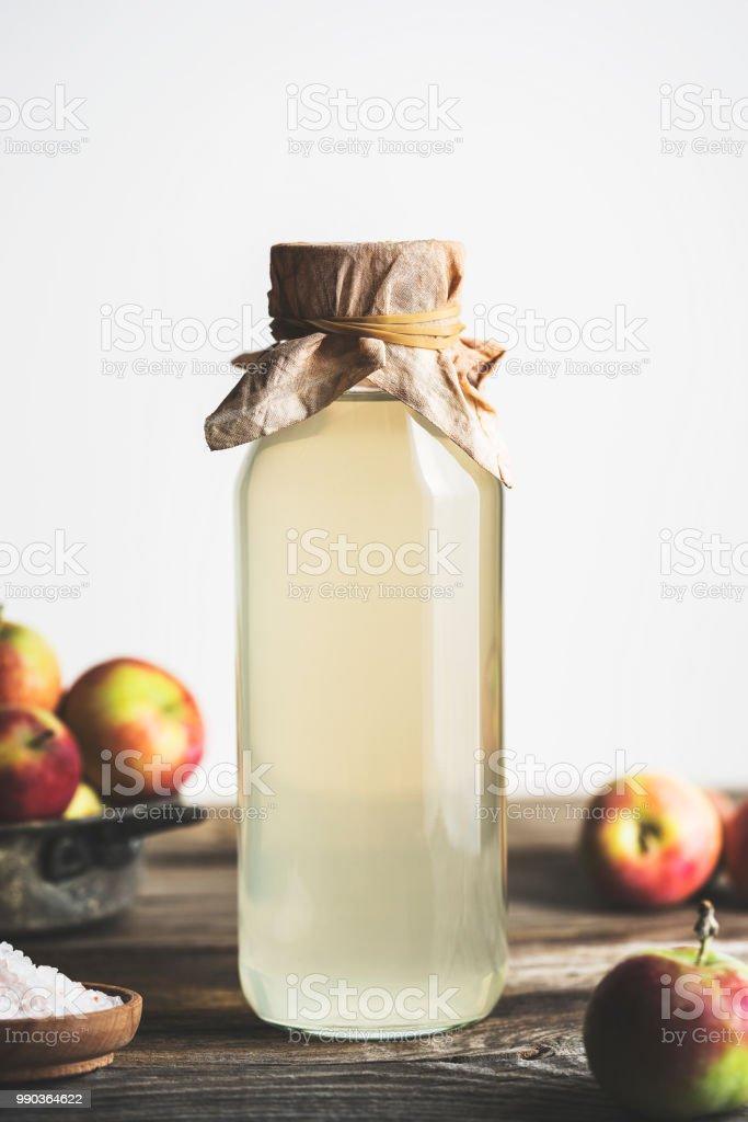 Bottle of apple cider vinegar on white background stock photo