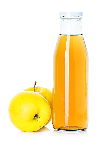 bottle of apple juice bottle of apple juice apple cider vinegar stock pictures, royalty-free photos & images