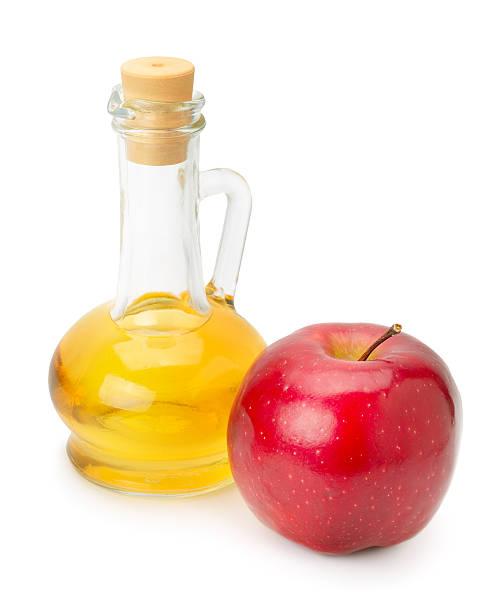 bottle of apple vinegar and apple stock photo