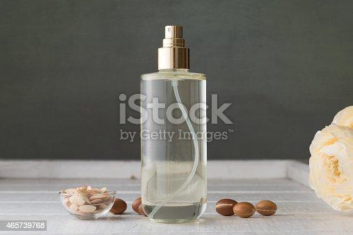 istock Bottle of Argan oil with fruit 465739768