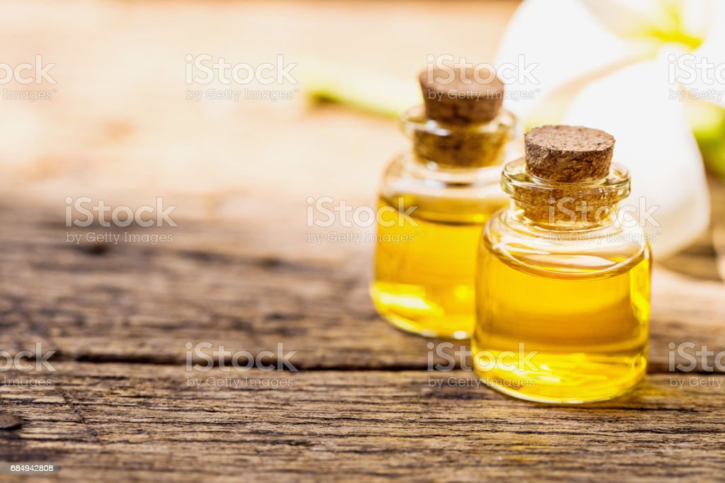bottle of aroma essential oil or spa and natural fragrance oil with dry flower Lizenzfreies stock-foto