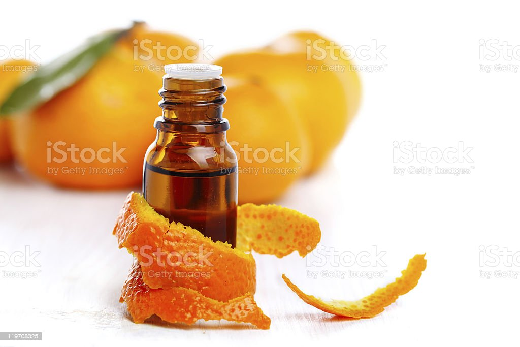 bottle of aromatic essence and fresh orange stock photo