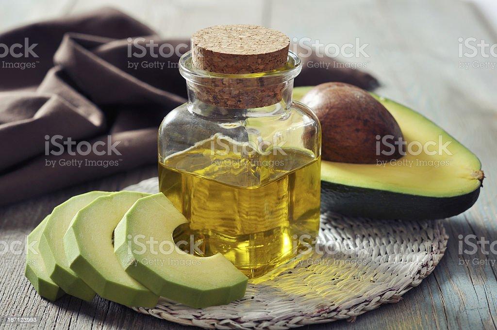 bottle of avocado essential oil stock photo