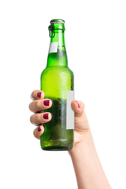Bottle of beer in hand stock photo