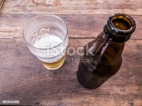 1073474208 istock photo Bottle of beer on a wooden table up 882940466
