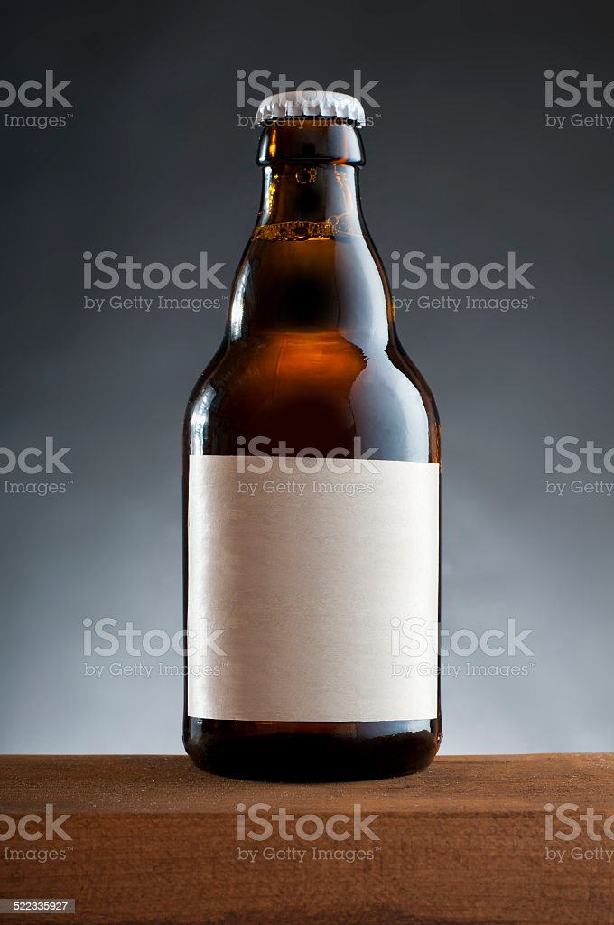 Bottle of beer on wooden table stock photo