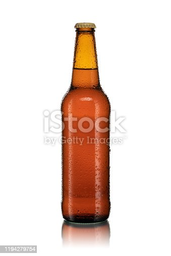 Bottle of beer covered with water drops on white background with reflection