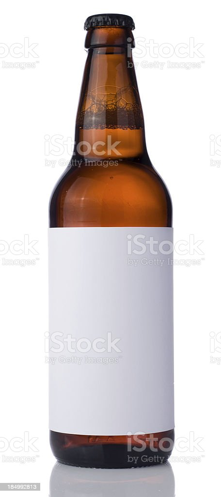 Bottle of beer with blank label on a white background stock photo