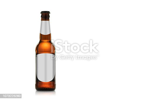 Bottle of beautiful amber colored beer with empty sticker isolated on white background. With clipping path.
