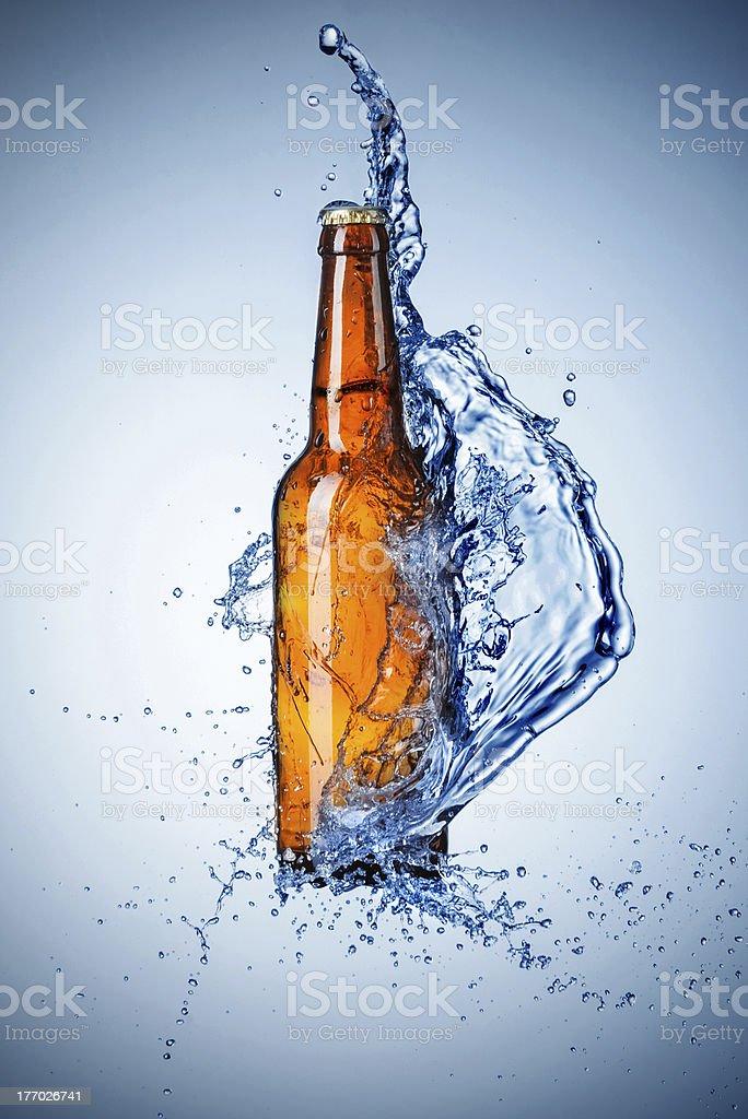 Bottle of beer with water splash stock photo