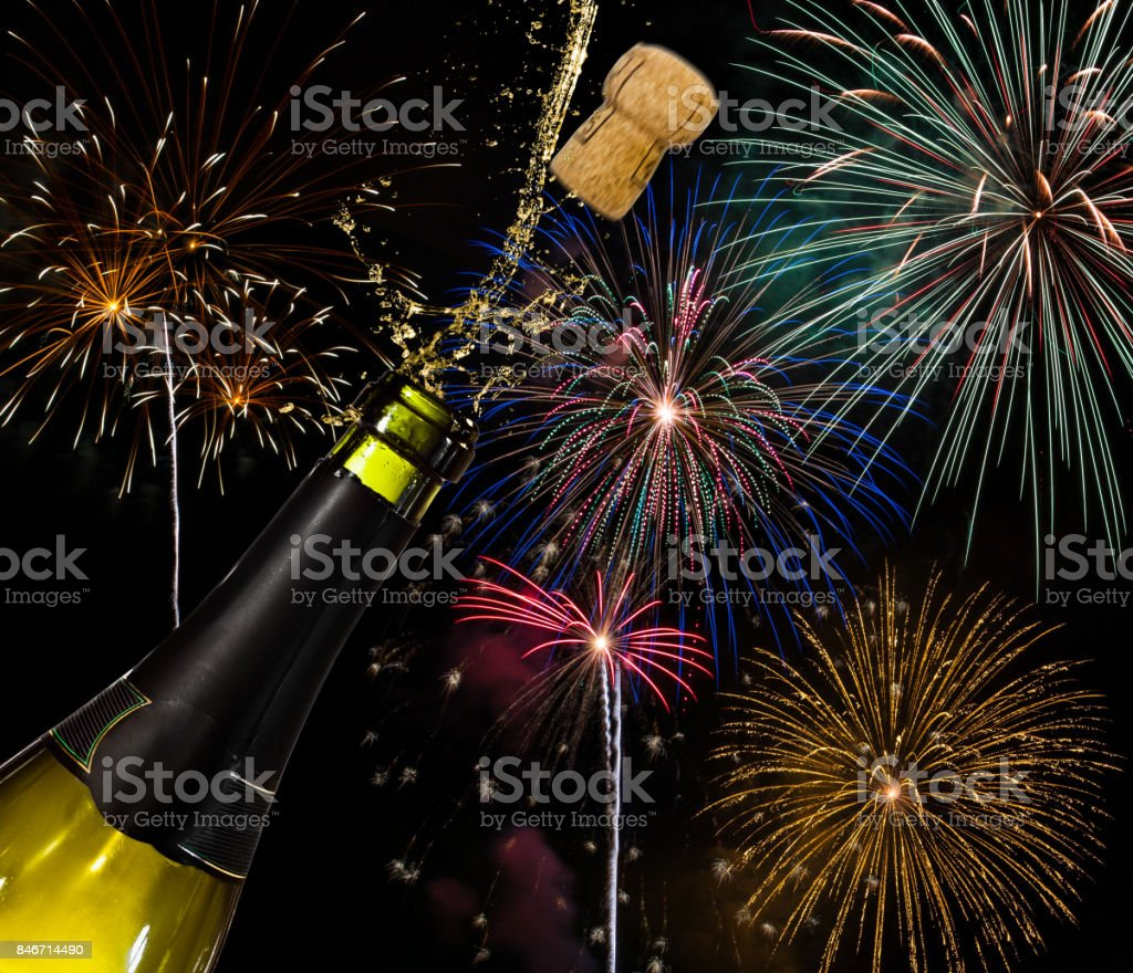 Bottle of champagne and fireworks stock photo