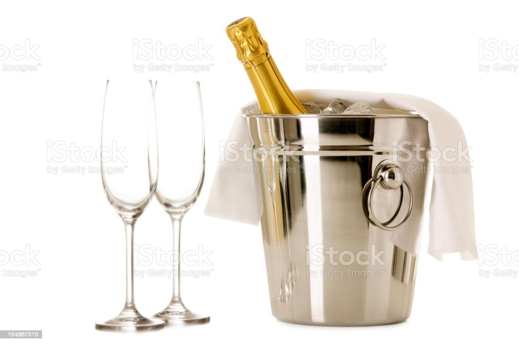Bottle of Champagne in cooler with two glasses stock photo