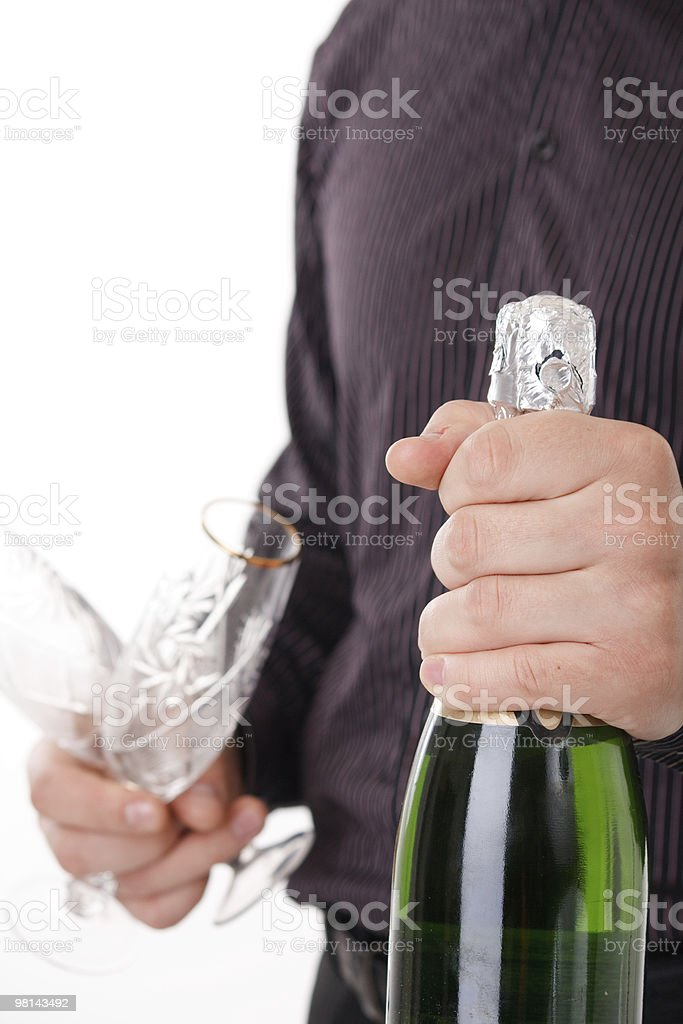 bottle of champagne in the hand royalty-free stock photo