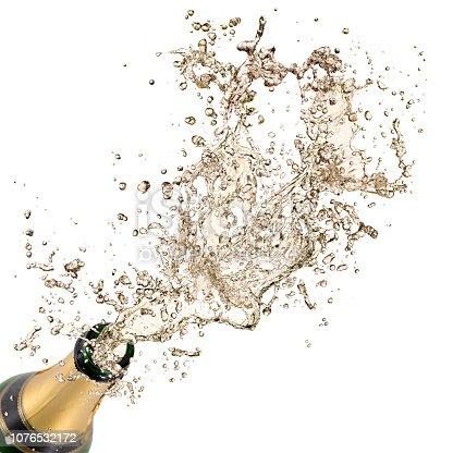 Bottle of champagne with splashing liquid, New year 2019 celebration theme.