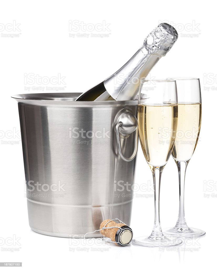 Bottle of champagne on ice bucket and two glasses stock photo