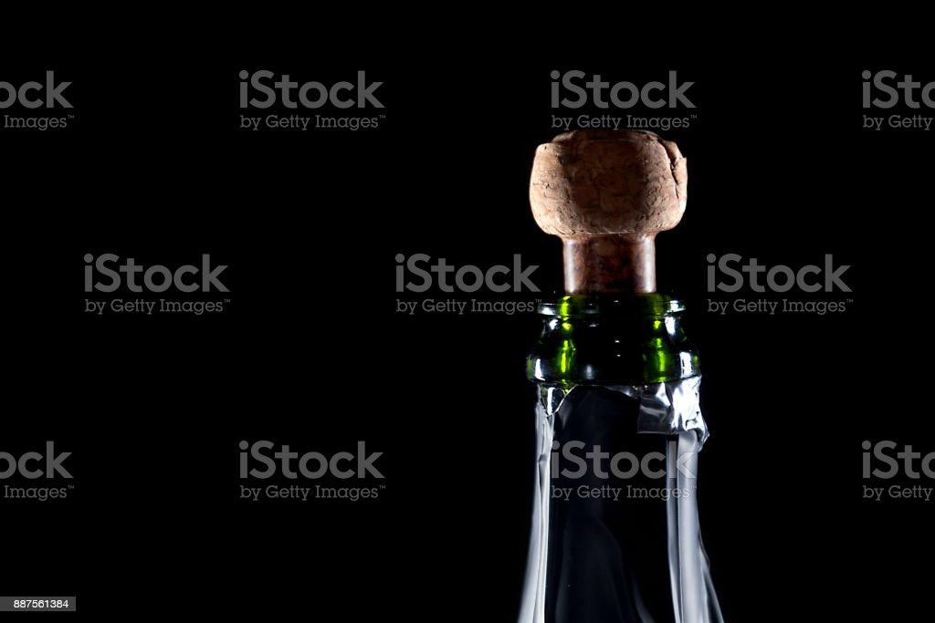 bottle of champagne uncork on black background stock photo