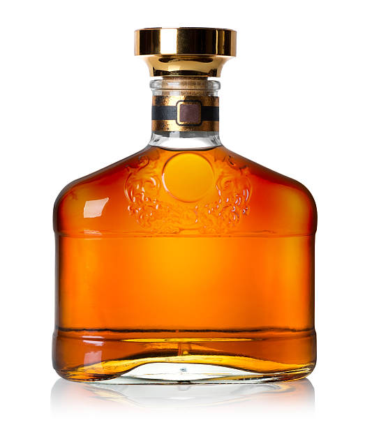 Bottle of cognac Bottle of cognac isolated on a white background brandy stock pictures, royalty-free photos & images