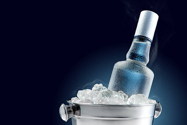 Bottle of cold vodka in bucket of ice - Photo