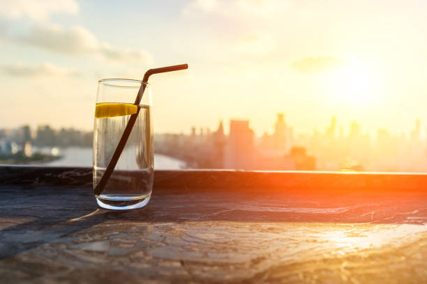 A bottle of drink on the rooftop, city skyline background stock photo