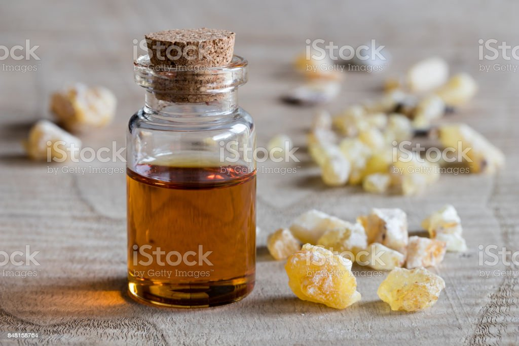 A bottle of frankincense essential oil stock photo