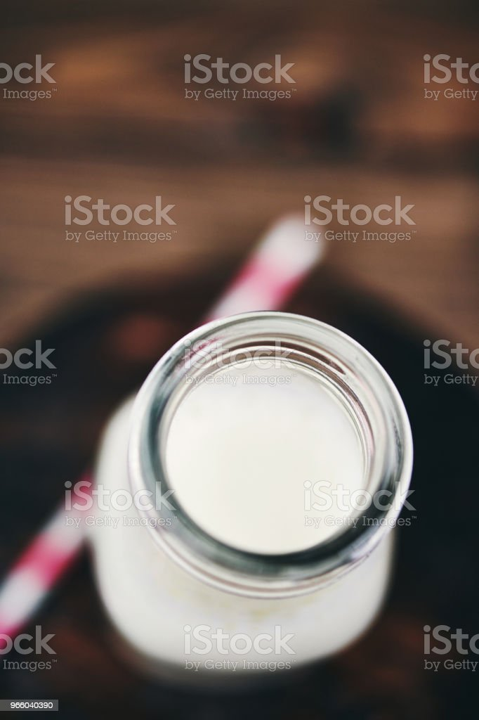 Bottle of fresh milk with pink straw - Royalty-free Above Stock Photo