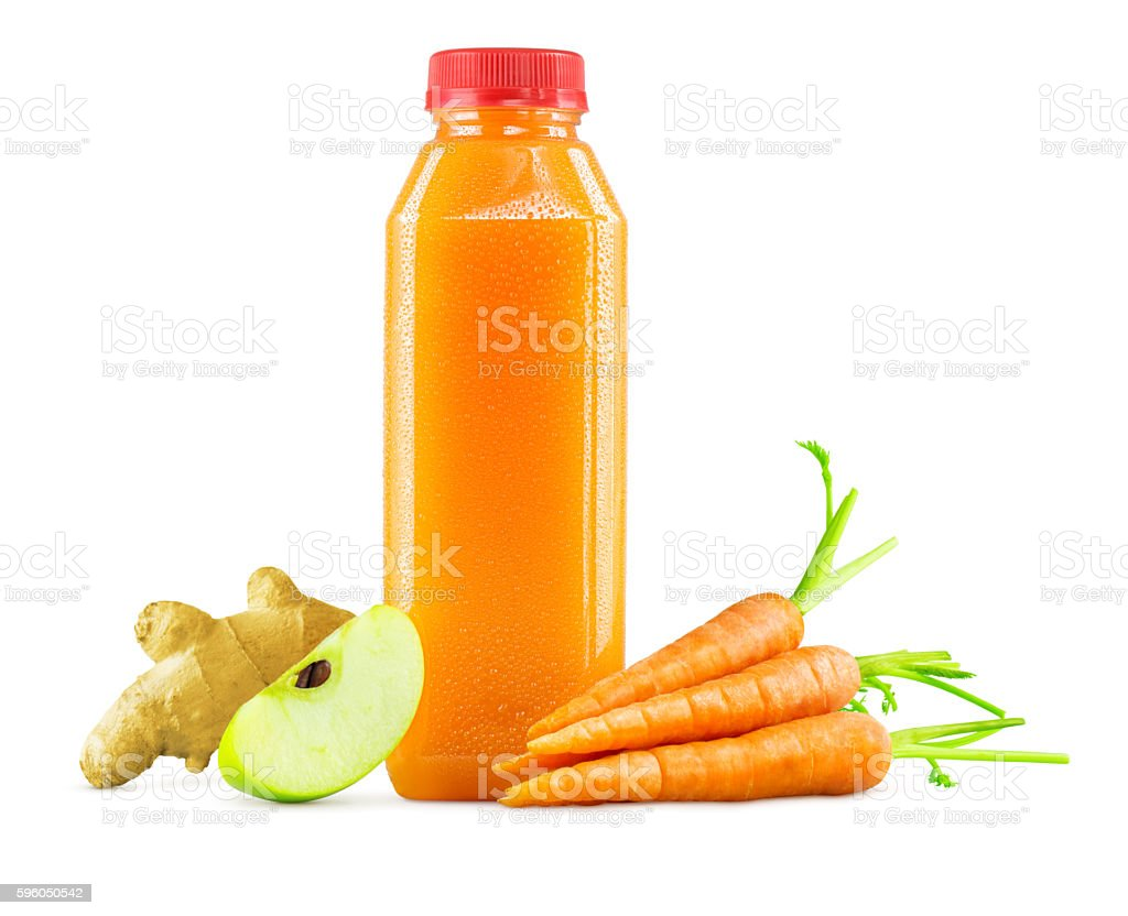 Bottle of Freshly Squeezed Carrot, Apple and Ginger Juice royalty-free stock photo