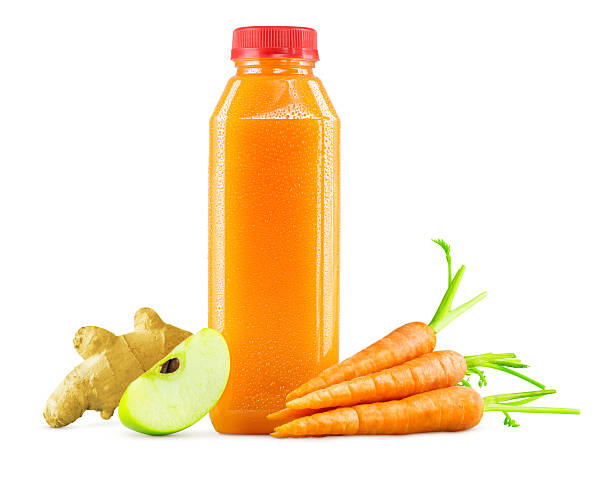 bottle of freshly squeezed carrot, apple and ginger juice - fruit juice bottle isolated foto e immagini stock