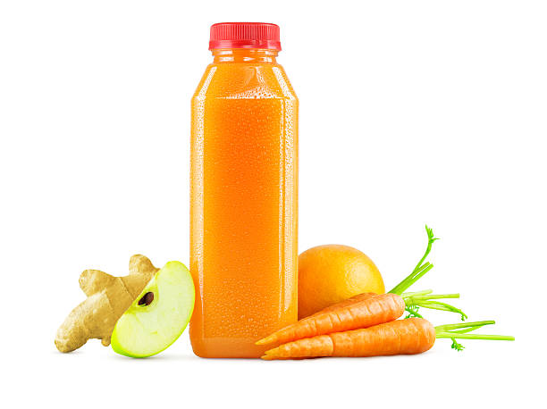 bottle of freshly squeezed carrot, apple, orange and ginger juice - fruit juice bottle isolated foto e immagini stock