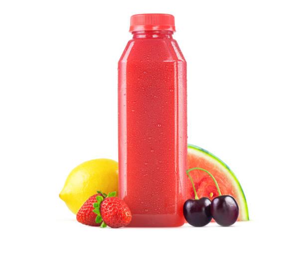 bottle of freshly squeezed watermelon berry lemonade juice - fruit juice bottle isolated foto e immagini stock