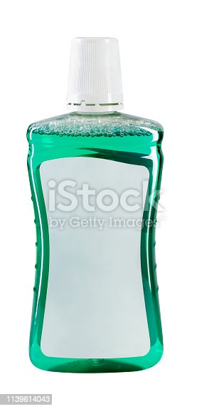 Bottle of green mouthwash with blank label
