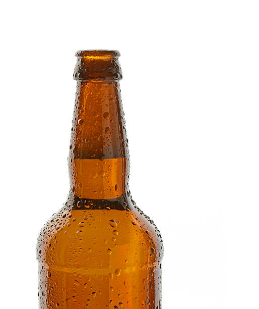 Bottle of ice cold beer Bottle of ice cold beer bitter ale stock pictures, royalty-free photos & images