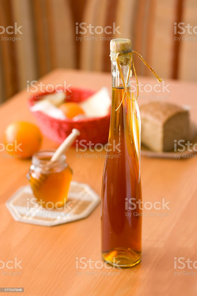 Bottle of mead - honey products royalty-free stock photo