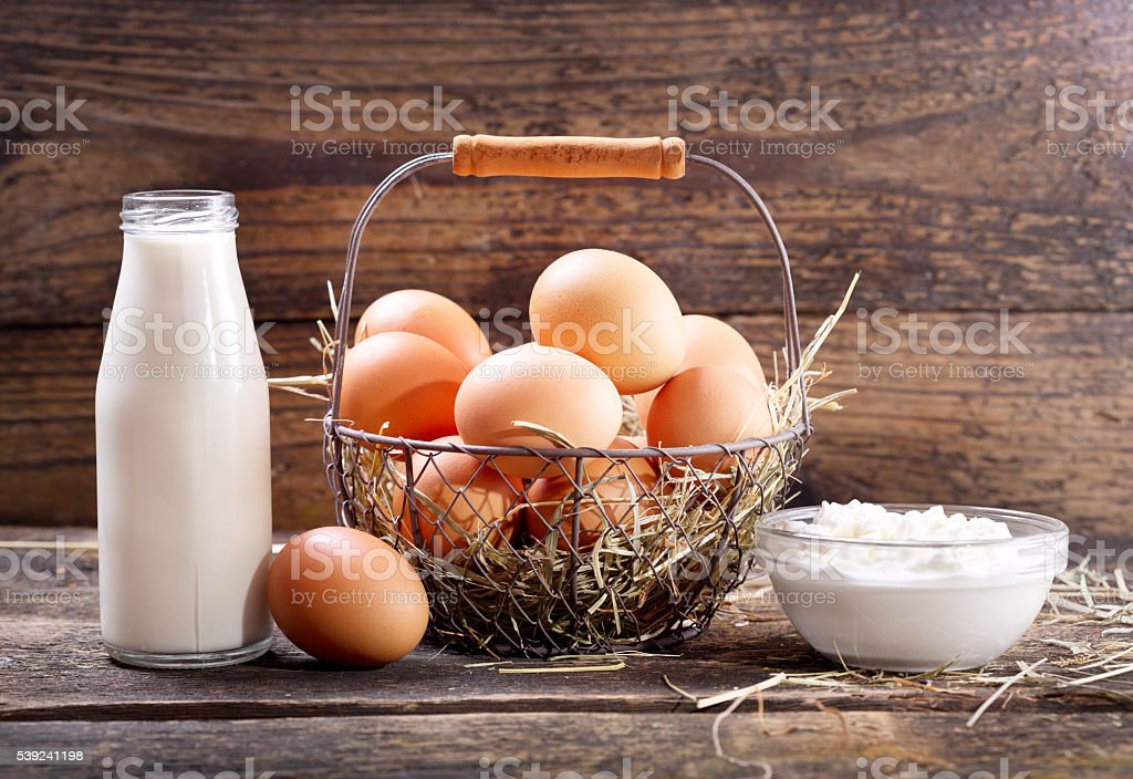 bottle of milk, fresh eggs and bowl of cottage cheese royalty-free stock photo
