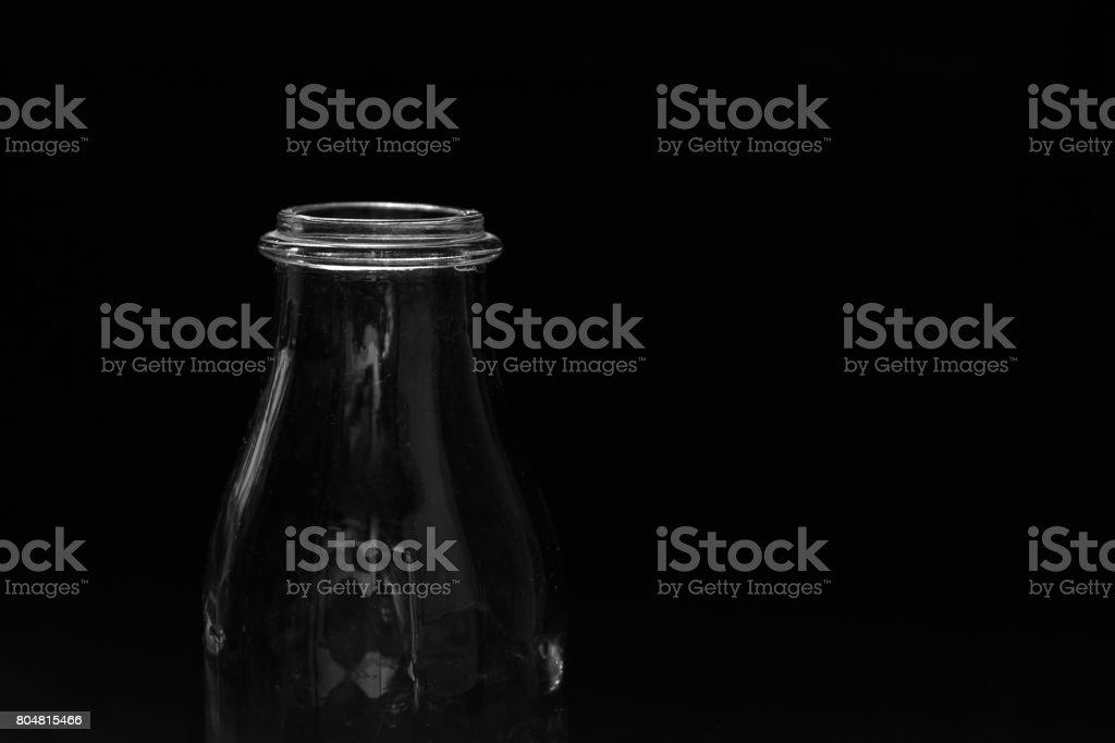 Bottle of milk on a black background stock photo
