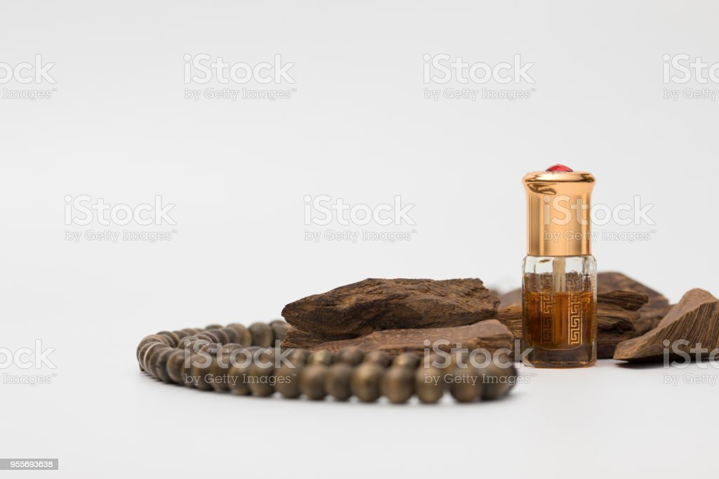 Bottle of oil agarwood perfume with Incense Chips isolated on white background stock photo