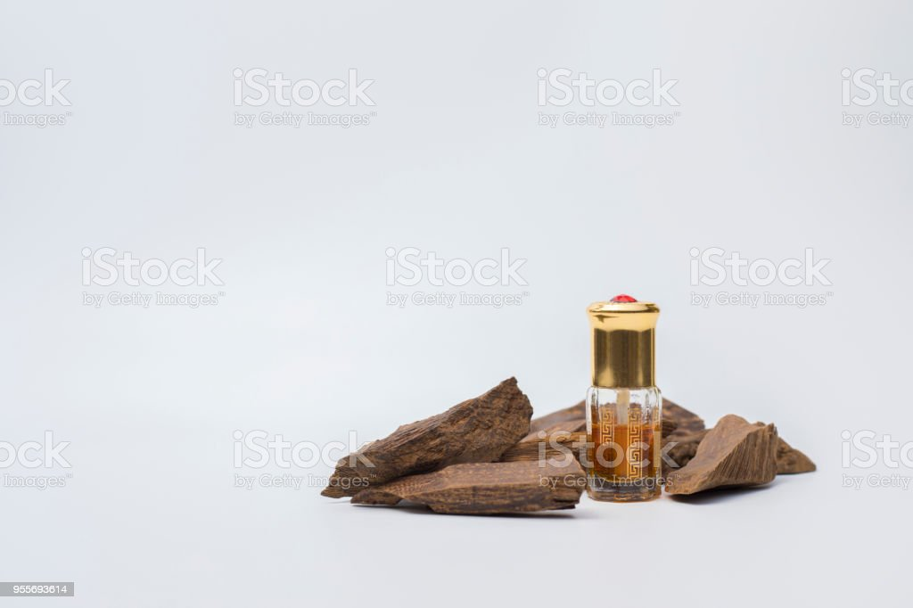 Bottle of oil agarwood with Incense Chips isolated on white background stock photo
