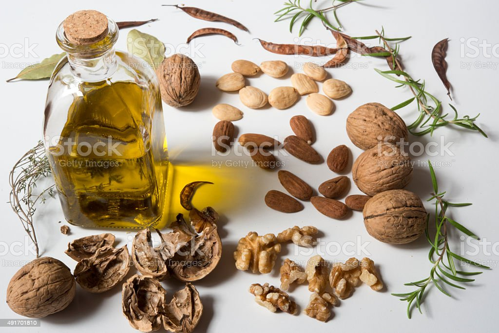 bottle of oil and nuts stock photo