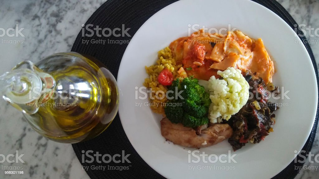 Bottle of olive oil and good food stock photo