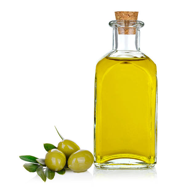 Bottle of olive oil with olives on white stock photo