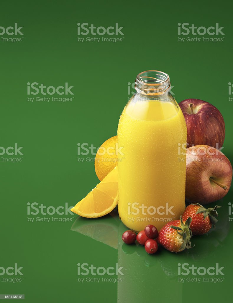 Bottle of Organic Juice with ingredients royalty-free stock photo