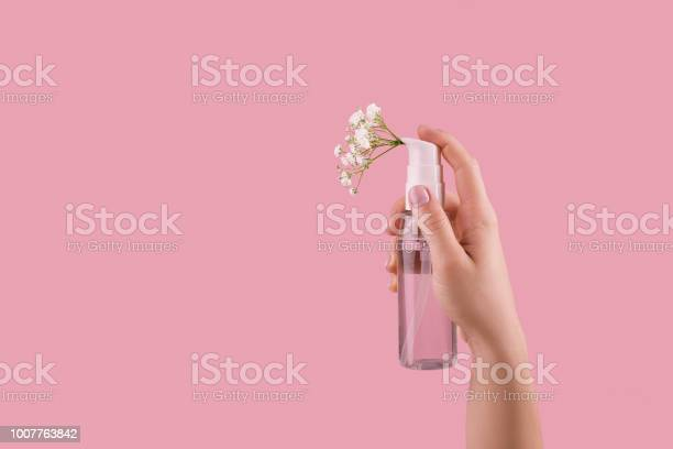 Bottle of perfume with spray scent of flowers picture id1007763842?b=1&k=6&m=1007763842&s=612x612&h=jdbi65lliavxab cxotte9oo9tlvnejkr dax20soyu=