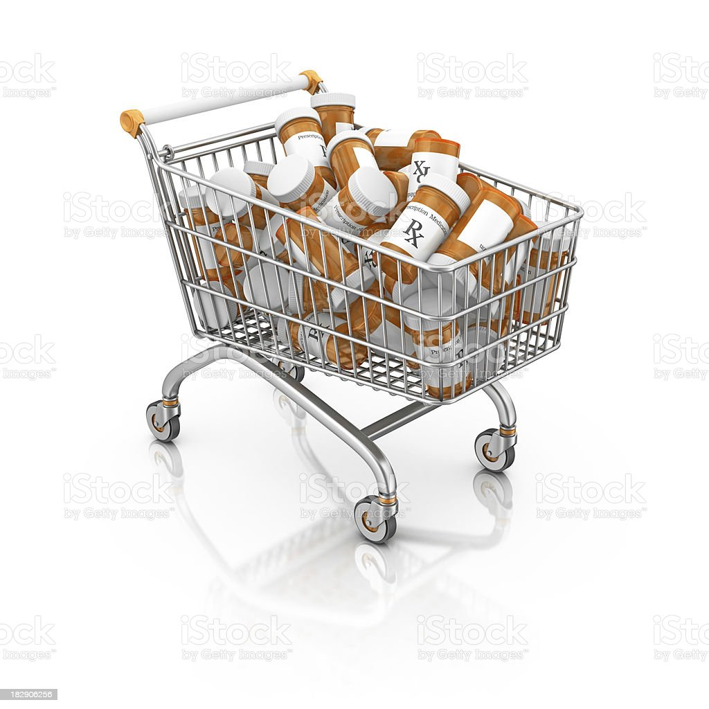 bottle of pills in shopping cart royalty-free stock photo