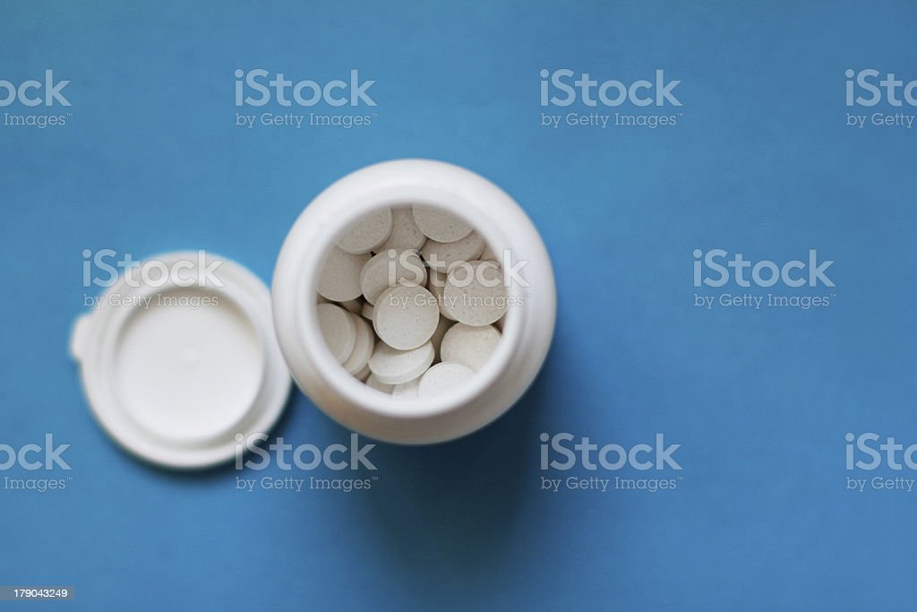 Bottle of pills top view stock photo
