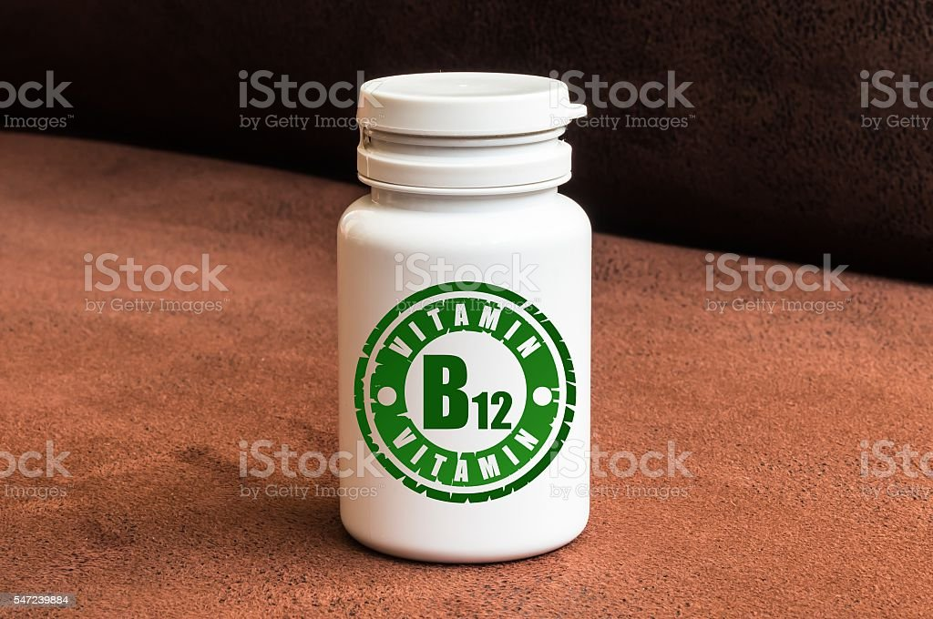 Bottle of pills with vitamin B12 stock photo