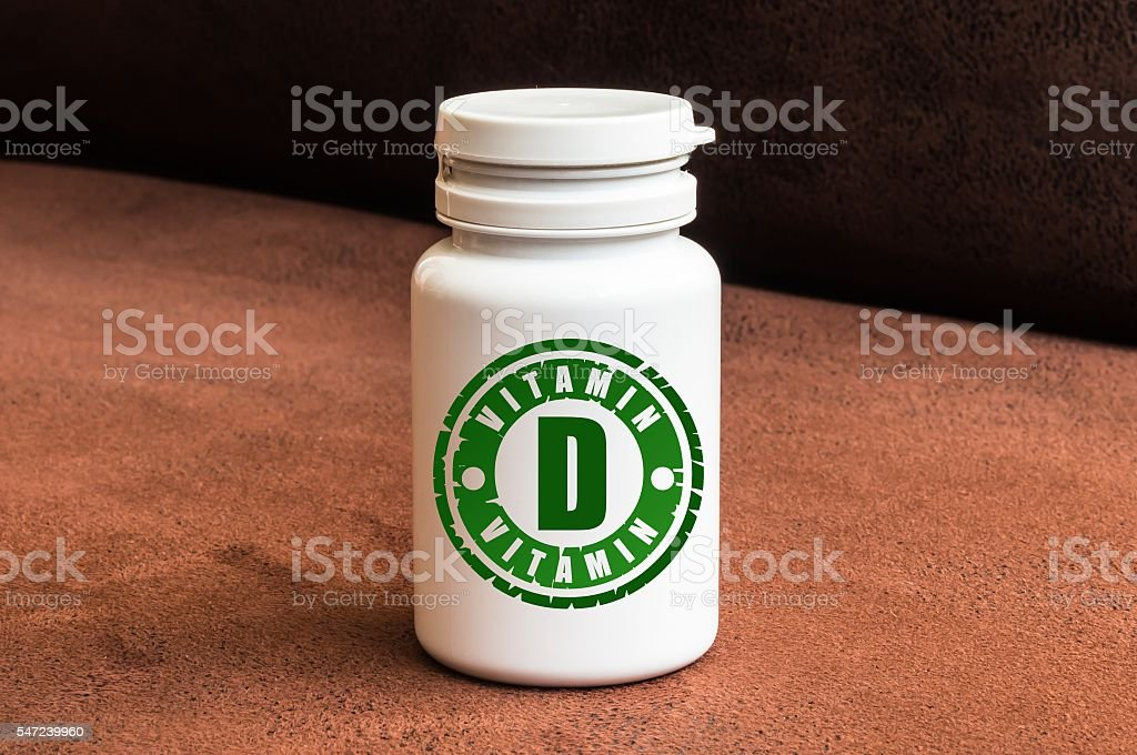 Bottle of pills with vitamin D stock photo
