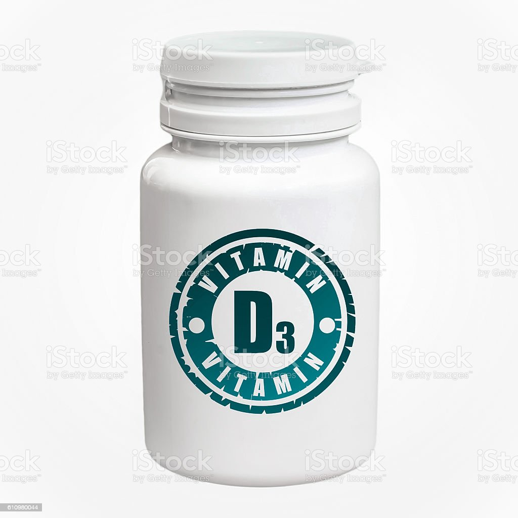 Bottle of pills with vitamin D3 stock photo