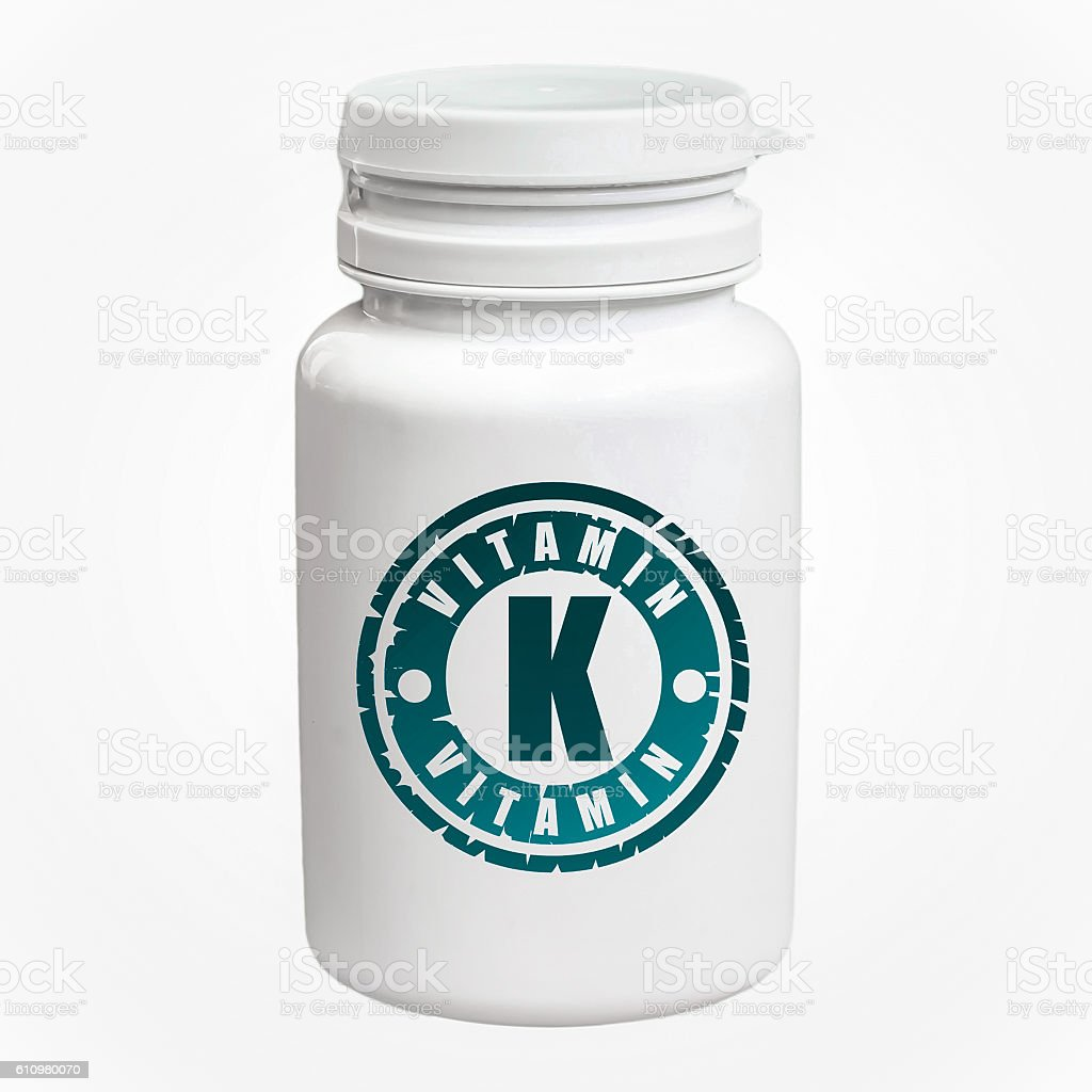 Bottle of pills with vitamin K stock photo