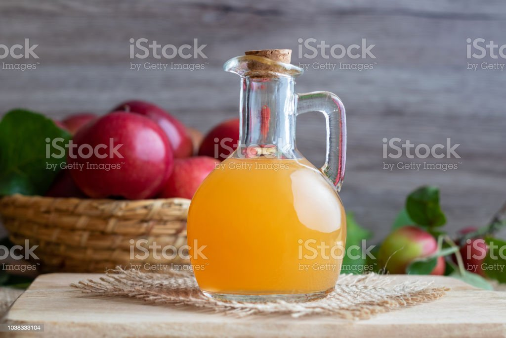 A bottle of raw unfiltered apple cider vinegar stock photo