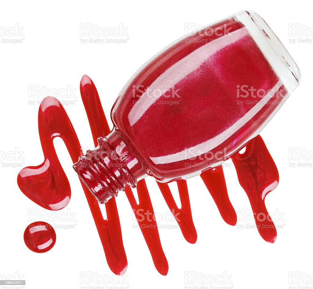 Bottle of red nail polish with enamel drop samples, isolated royalty-free stock photo